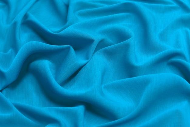 Мягкая шелковая ткань или текстура атласной ткани. морщинистый узор ткани. tidewater green - цветовой тренд 2021 года. Premium Фотографии