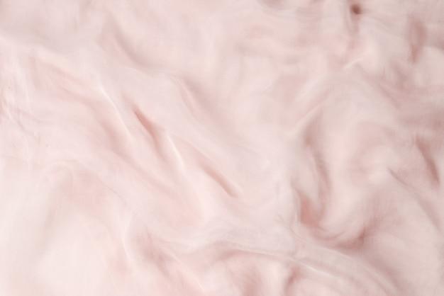 柔らかく滑らかなピンクのシルク生地の背景。生地の質感。