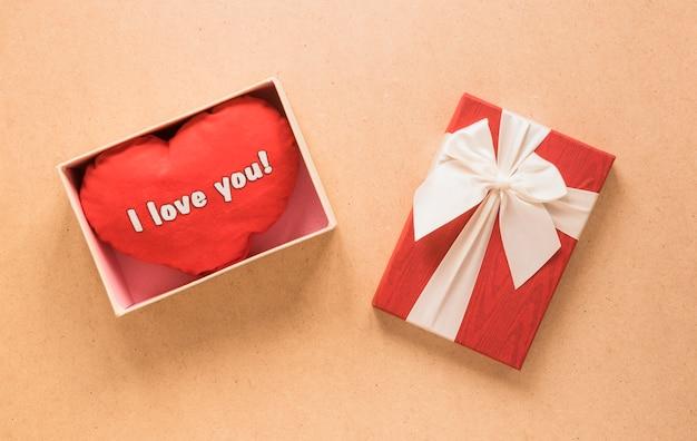 Soft symbol of heart in present box