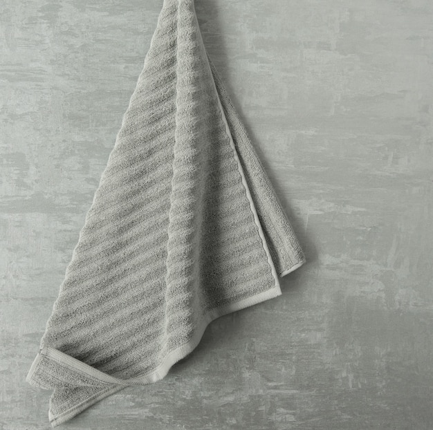 Soft towel in a grey  decorative stucco background. top view, isolated