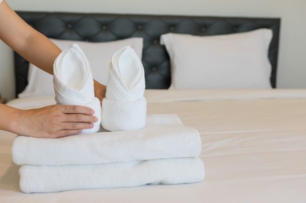 Soft towels on bedroom.