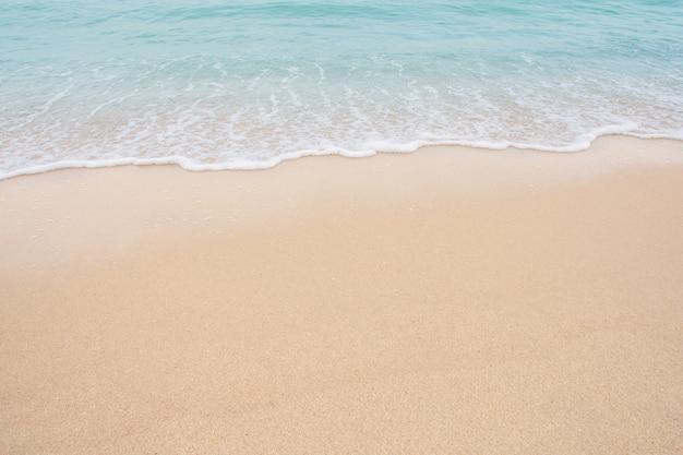 Soft wave of sea on empty sandy beach