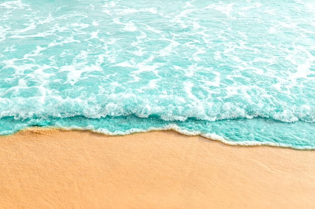 Soft wave of turquoise ocean on sandy beach