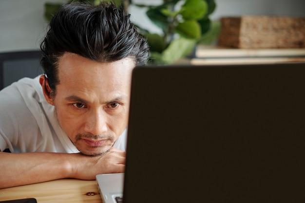 Software developer looking at programming code