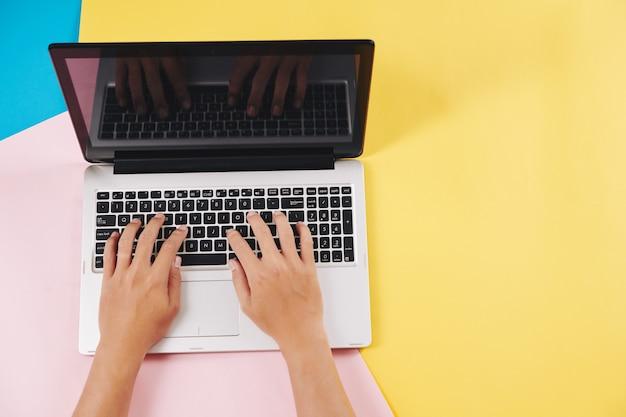 Software developer working on laptop