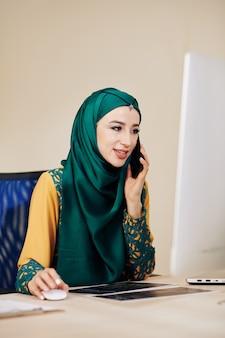 Software engineer talking on phone