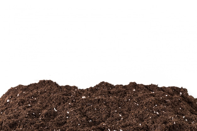 Soil or dirt section isolated on white
