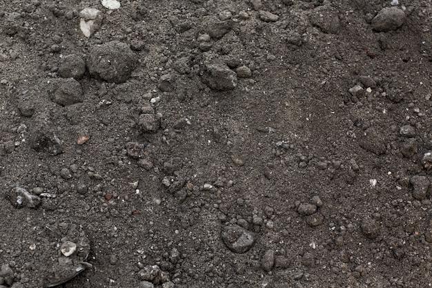 Фоновый узор текстуры земли почвы. грязная земля.