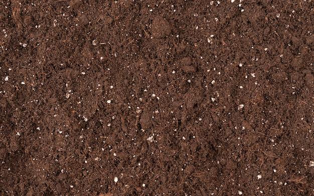 Деталь текстуры почвы для садоводства вид сверху для дизайна плодородной почвы на земле Premium Фотографии