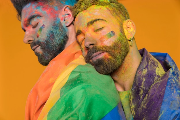 Soiled in paint gay snuggling on boyfriend