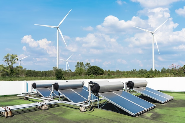 Solar cell energy panels and wind turbines with blue sky