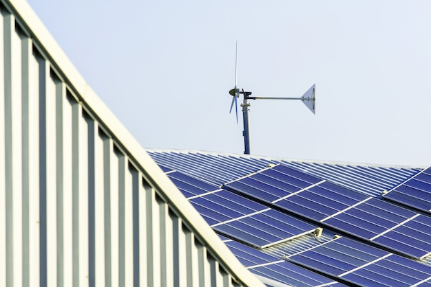 Solar cell panel and wind turbines on factory roof