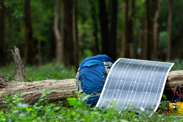 Solar cell with backpack color blue in the forest