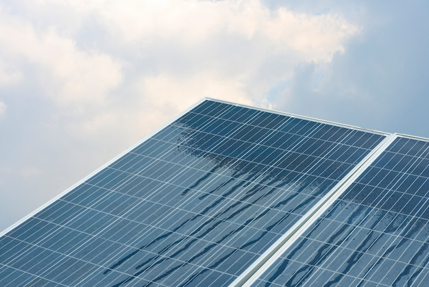 Solar cells are renewable energy with the sky background.