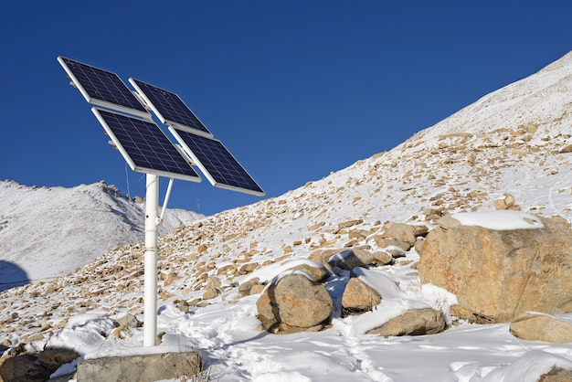 Solar cells panel on snow mountain in ladakh, india