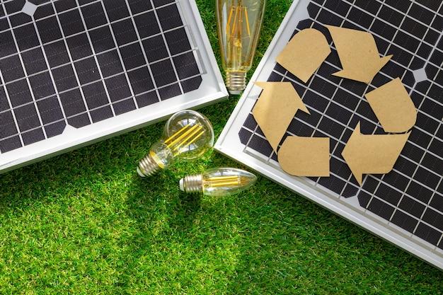 Solar energy panel and light bulb green energy