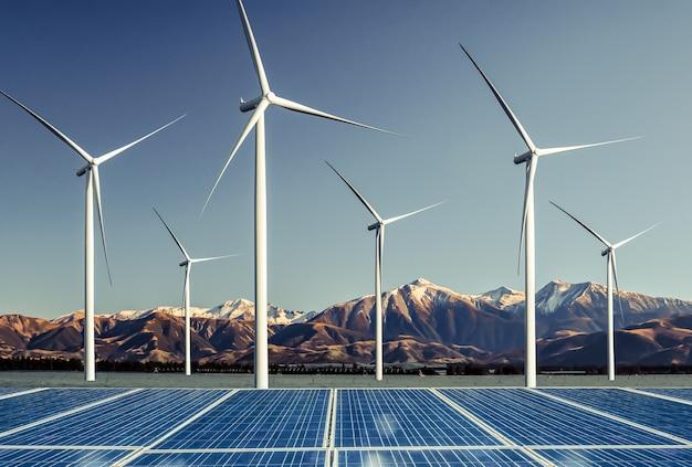 自然景観における太陽エネルギーパネル太陽電池と風力タービンファーム発電機。