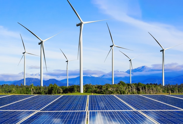 Solar energy panel photovoltaic cell and wind turbine farm power generator in nature landscape