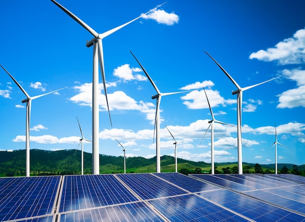 Solar energy panel photovoltaic cell and wind turbine farm power generator in nature landscape.