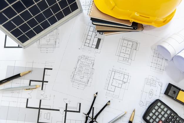 地球温暖化防止のための建築家の机solar energy powered home green。