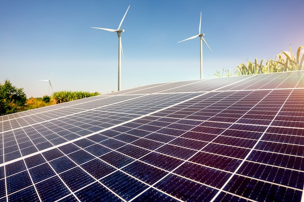 Solar energy in sugar farm and wind mill or wind turbine, green power, natural energy for farmer