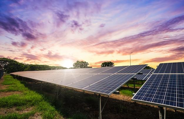 Solar panel cell on dramatic sunset sky, clean alternative power energy concept.