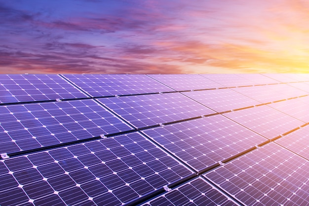 Solar panel on colorful sky background and sunlight