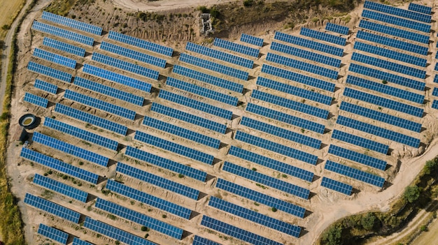 Solar panel farm seen from above in a rural landscape