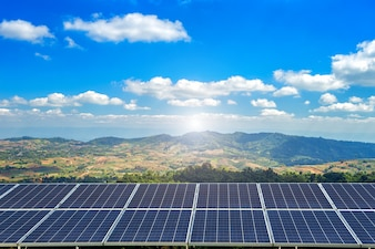 Solar panel on Forested Mountain blue sky background