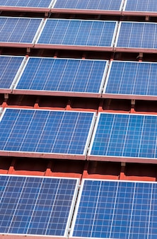 Solar panel pattern on red roof tile