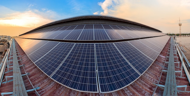 Solar panel photovoltaic installation on a roof of factory