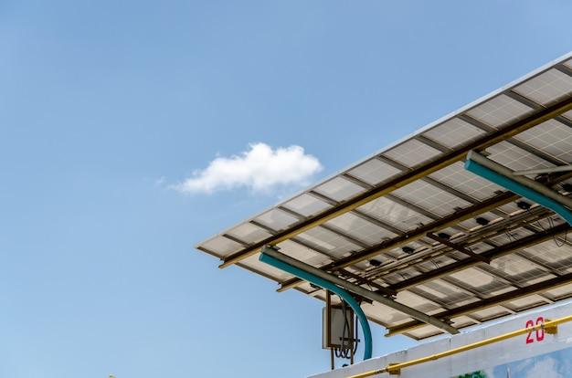 Under the solar panels against the deep blue sky