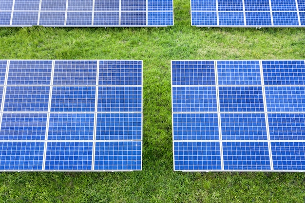 Solar panels producing renewable clean energy on green grass.