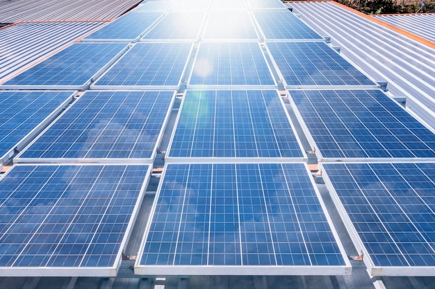 Solar panels on rooftop with sun reflect light power for alternative energy photovoltaic safe energy