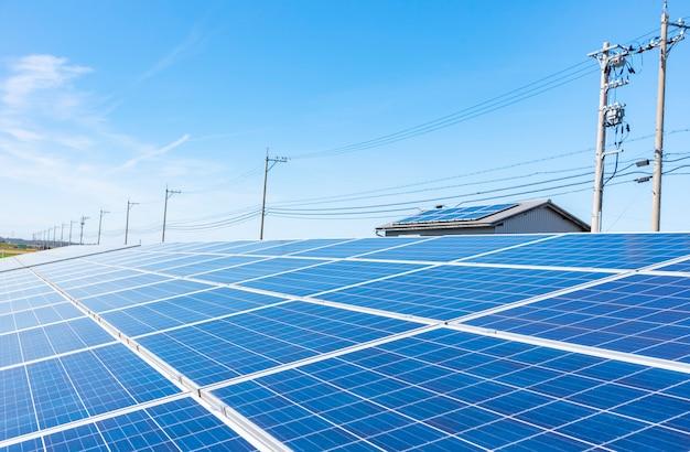 Solar panels (solar cell) in solar farm with blue sky and sun lighting