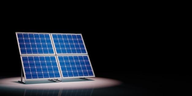 Solar panels spotlighted on black background