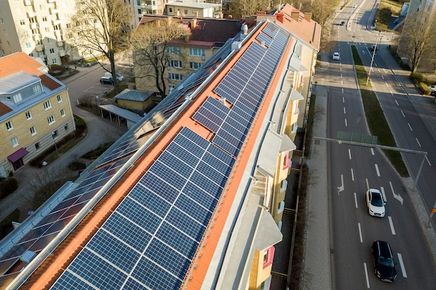 Solar panels system on high apartment building roof .