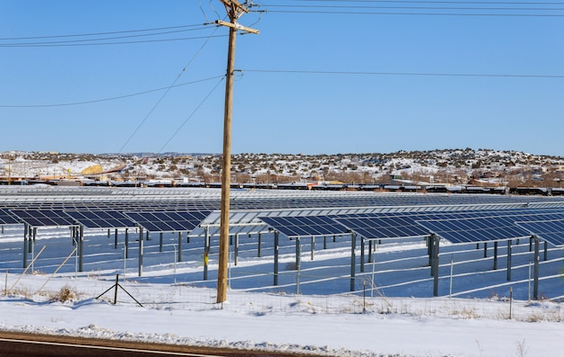 Solar panels in winter view of snow covered solar panel park, photovoltaic power station