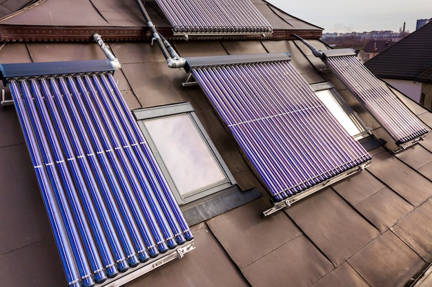 Solar water heating system on house roof. hot water boiler, alternative ecological sun energy generator. modern technology concept.