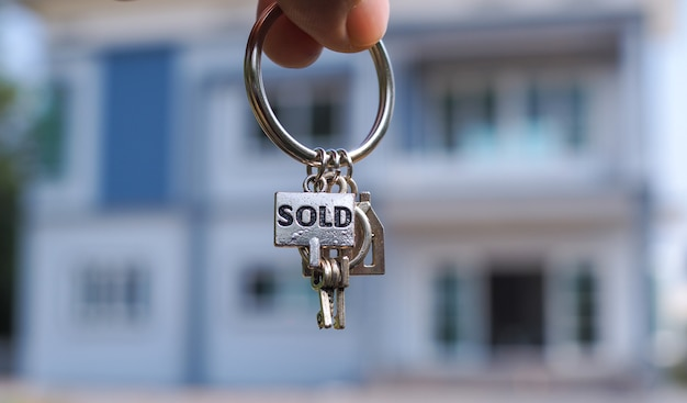 Sold house keys and blurry home