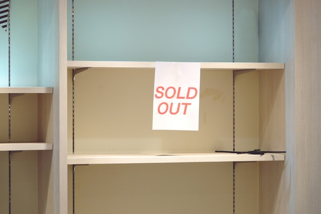 Sold out sign on empty shelves