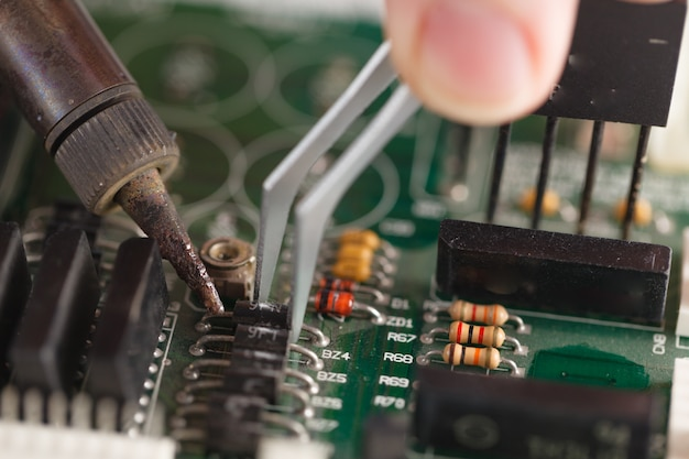 Soldering of computer motherboard