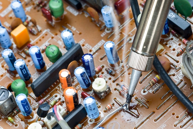 Soldering iron and verification testing of electronic boards