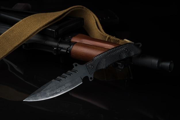 Solders combat knife and gun