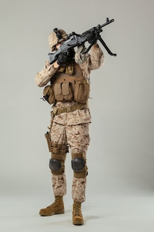 Soldier in camouflage holding rifle