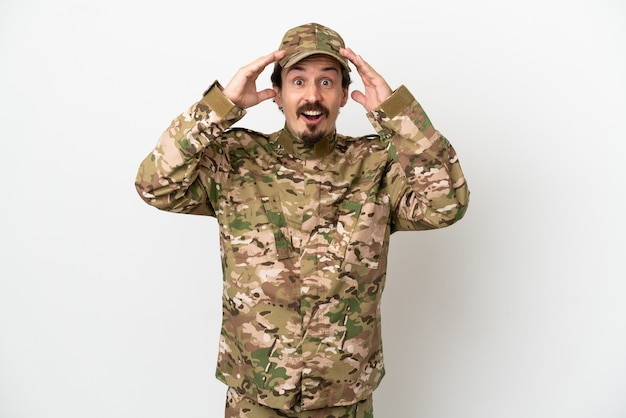 Soldier man isolated on white background with surprise expression