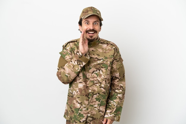Soldier man isolated on white background with surprise and shocked facial expression