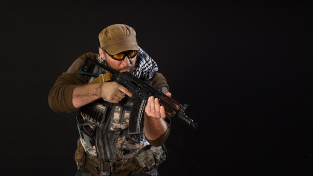 Soldier mercenary with a gun aiming at the enemy.