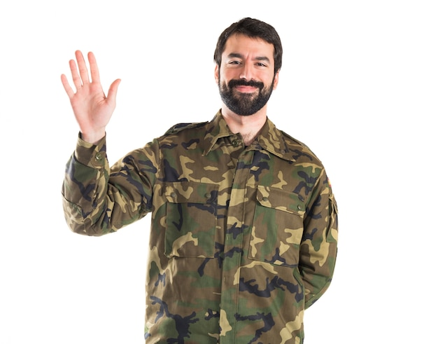 Soldier saluting over white background
