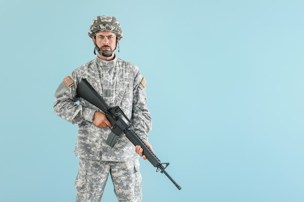 Soldier with assault rifle on blue